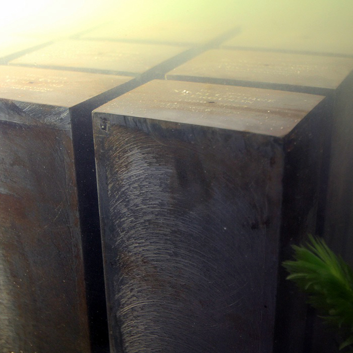 An underwater graveyard made up of large iron blocks