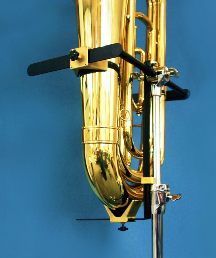 A shiny euphonium clamped in place at an angle.