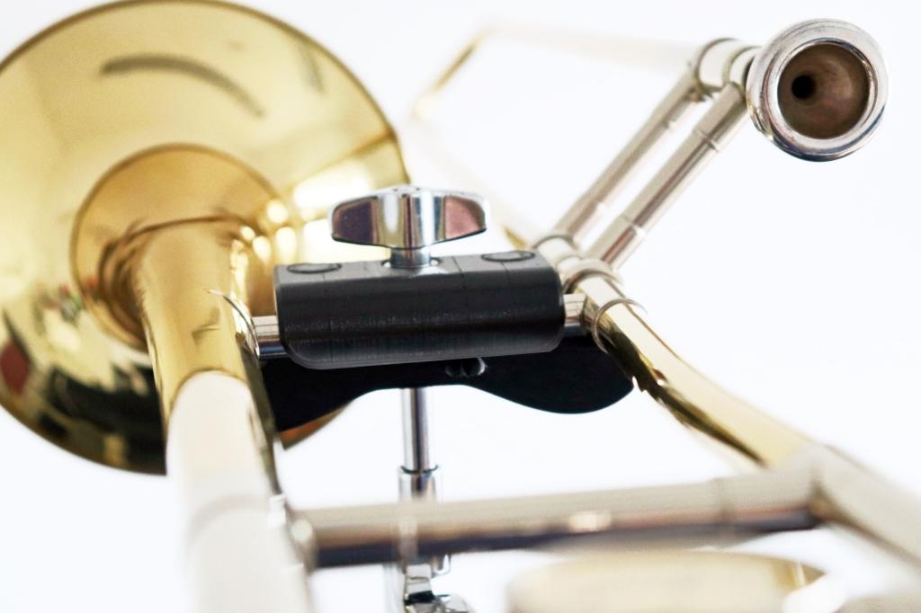 A moustache shaped clip holding up a trombone